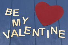 Be my valentine on a blue background stock photo