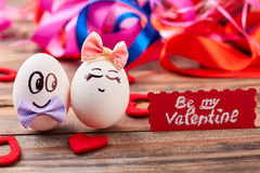 Be my Valentine card. Love eggs, hearts, colorful backdrop. How to invite a girl royalty free stock photo