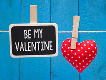 Be my Valentine - chalkboard with red heart. On blue wooden background Royalty Free Stock Images