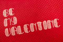 Be My Valentine cross stitched on red Stock Photography