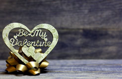 Be My Valentine hand made heart and bow. Decorative hand made heart on wooden background. Be My Valentine inscription. Heart of decoupage technique. Beautiful Royalty Free Stock Photo