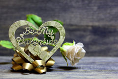 Be My Valentine hand made heart. Decorative hand made heart and rose flower on wooden background. Be My Valentine inscription. Heart of decoupage technique Royalty Free Stock Photos