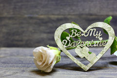 Be My Valentine hand made heart and rose. Decorative hand made heart and rose flower on wooden background. Be My Valentine inscription. Heart of decoupage Royalty Free Stock Photography