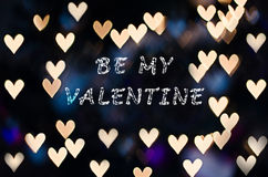 Be my Valentine with heart bokeh. Heart bokeh - Valentine's Day background Royalty Free Stock Image