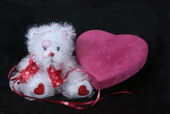 Be My Valentine. A valentine heart, ribbon and plush teddy bear are an invitation to be someone's sweetheart Royalty Free Stock Photo