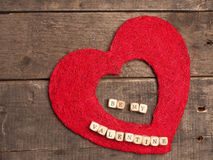 Be my valentine. Love concept background, with red heart shape on rustic wood with the words, be my valentine stock photography