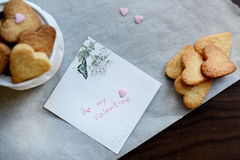Be my Valentine Note and Bunch of Heart Shaped Cookies Royalty Free Stock Image