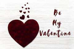 Be my valentine text sign. stylish velvet big and little hearts. Flat lay on white wooden background. happy valentines day concept. greeting card with space for Royalty Free Stock Photography