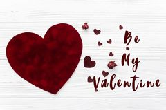 Be my valentine text sign. valentine concept flat lay. stylish. Velvet hearts on white wooden background. happy valentines day. greeting card with space for Royalty Free Stock Photography