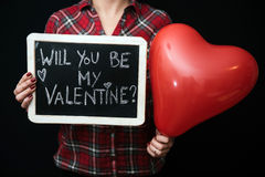 Be my valentine. Woman holding be my valentine sign Stock Images
