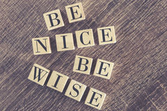 Be Nice Be Wise message formed with wooden blocks Stock Image