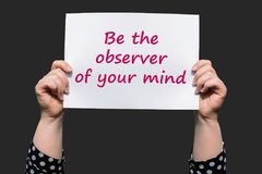 Be the observer of your mind. Motivational sign woman holding by hand stock images