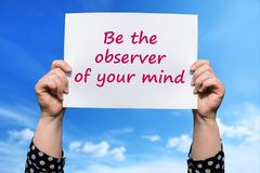 Be the observer of your mind. Motivational sign woman holding by hand stock photography