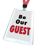 Be Our Guest Badge Lanyard Welcome Visitor. Be Our Guest words on a badge with lanyard to illustrate welcome hospitality for a visitor or newcomer to a business Royalty Free Stock Photography
