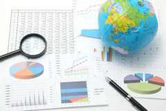 Be, pen, business items, and business documents with numbers and charts. Stock Photo