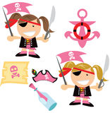 We be pirates at the sea. Arghh! We Be Pirates! two girls of different hair color and matching pirate items including a pirate map , ship anchor , pirate hat and Stock Photo