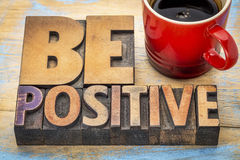 Be positive banner in letterpress wood type Royalty Free Stock Images