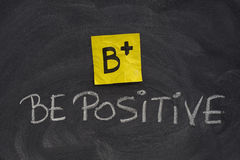 Be positive concept on blackboard Stock Images