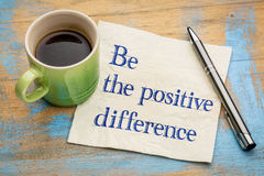 Be the positive difference. Handwriting on a napkin with a cup of espresso coffee Stock Photography