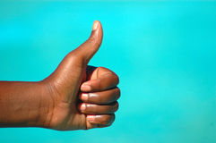 Be positive hand. A black hand of an African American woman with thumb up to show a positive future Stock Photo