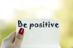 Be positive. Optimistic note on green background Stock Photos