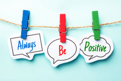Always Be Positive. Paper speech bubbles with text Always Be Positive hanging on the line royalty free stock images