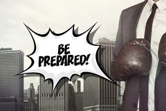 Be prepared text with businessman wearing boxing Stock Images