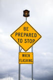 Be prepared to stop when flashing, road sign Stock Photo