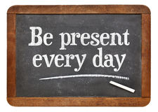Be present every day advice on blackboard Stock Photo