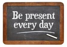 Be present every day advice on blackboard Stock Photo