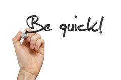 Be quick handwritten. Be quick phrase handwritten on whiteboard Royalty Free Stock Photography
