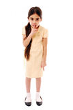 Be quiet. Schoolgirl with finger on lips, telling class to be quiet isolated on white Stock Photos