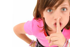 Be Quiet. Beautiful 10 year old girl making hush gesture looking up at camera. Top view over white background stock photos