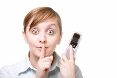 Be quiet. Woman holding mobile phone and holding finger on lips to be quiet Stock Photography