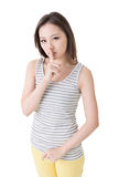 Be quiet. Asian woman saying hush be quiet. Isolated over white Royalty Free Stock Photo