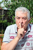 Be quiet-elderly man close up. Royalty Free Stock Photography