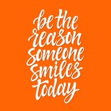 Be the reason someone smiles today - vector brush pen lettering. White text on orange background. High quality calligraphy for card, print, poster. Popular Royalty Free Stock Images
