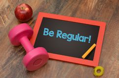 Be Regular fitness and health goals dumbbell and measure tape Royalty Free Stock Image