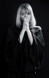 be religiös kvinna Arkivbild