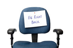 Be Right Back. Office chair with a BE RIGHT BACK sign isolated on white background Royalty Free Stock Image