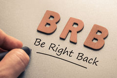 Be Right Back Abbreviation. Wood letters as abbreviation of Be Right Back stock photography