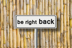Be right back written on road sign Royalty Free Stock Image