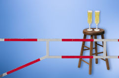 Be safe. Alcohol concept.Security point gateway, wooden stool and two champagne glasses on it Royalty Free Stock Photos