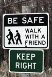 Be Safe Sign. Sign reading - be safe, walk with a friend and keep right Stock Images