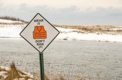 Wear It Don`t Risk It Sign at a River Stock Images
