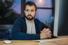 Concentrated bearded man still working Royalty Free Stock Images