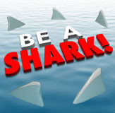 Be A Shark Aggressive Attack Fins Fierce Deadly Force. Be a Shark words in 3d letters on water with fins around it to illustrate fierce, aggressive, competitive Royalty Free Stock Photography