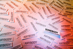 Be Somebody. A lot of anybody and accented somebody, words written on white papers Royalty Free Stock Photography