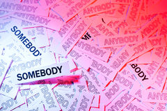Be Somebody. A lot of anybody and accented somebody, words written on white papers Stock Photo