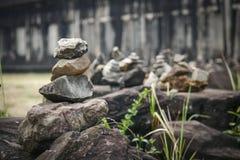 Be stenen i Angkor Wat Royaltyfria Bilder